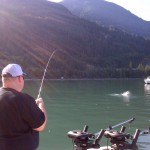 Customer reeling in a Pink Salmon on light takle