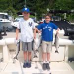 Children holding their first salmon catch.